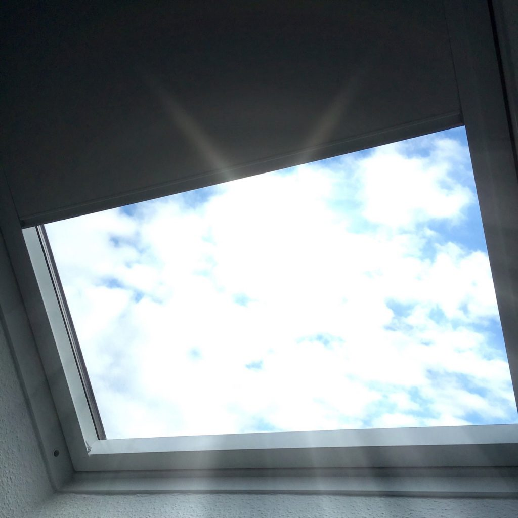 Midday sun is shining through the skylight